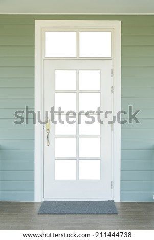 vintage white door on the green wall with a grey carpet - stock photo