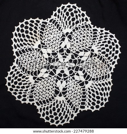 Vintage White Knitted Napkin Isolated On A Black Background