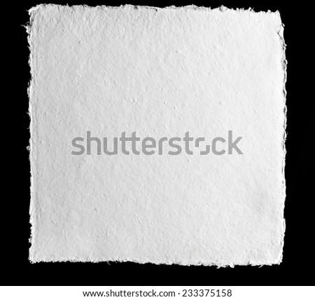 Vintage white pressed paper on black background - stock photo