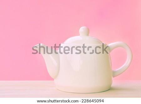 vintage white Teapot on pink Background - stock photo