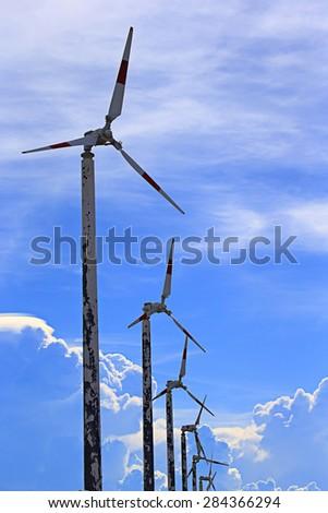 Vintage wind turbine over Irisation cloud, Image in Thailand. - stock photo