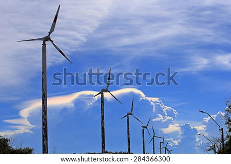 Vintage wind turbine over Irisation cloud, Image in Thailand. - stock photo