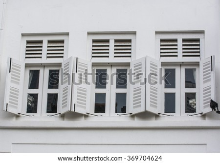 Vintage window on cement wall background. - stock photo
