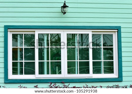 Vintage window on green cement wall can be used for background - stock photo