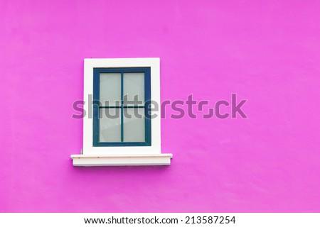 vintage window on pink wall - stock photo