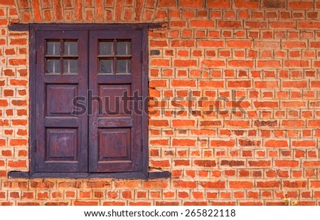Vintage window on Red brick wall background.