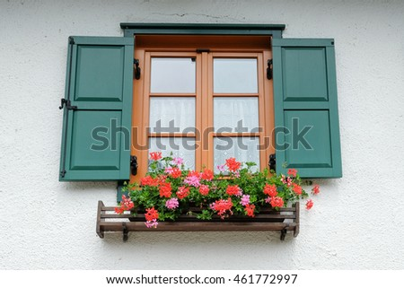 Vintage window on the white wall with roses