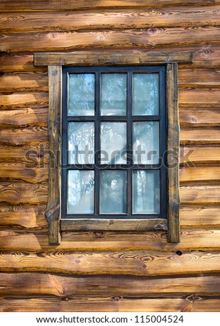 Vintage window on wooden wall - stock photo