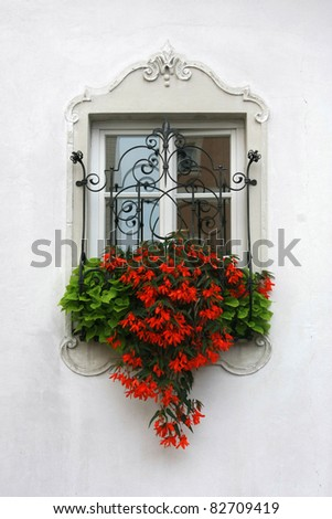 Vintage window with rusty decorative bars. - stock photo