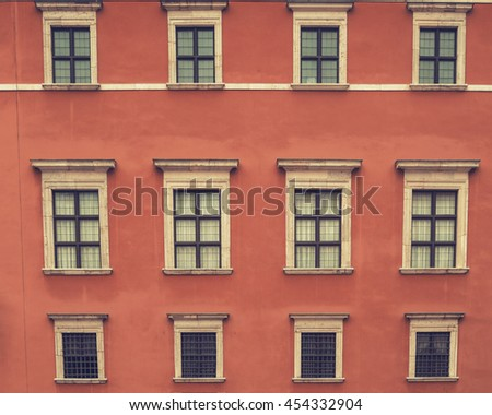 Vintage windows on the faded red coral pink wall.  Historical city elements Classic european architecture Postcard concept Travel inspiration Luxury estate background