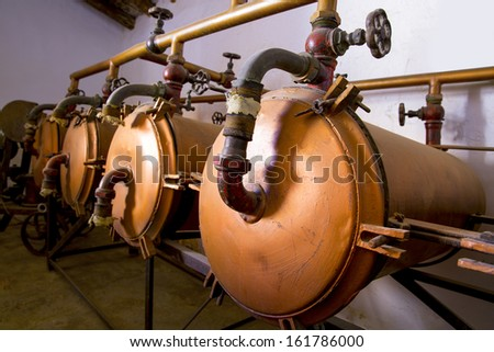 vintage winery tanks and pipes from mediterranean area - stock photo