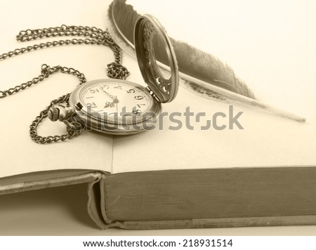 Vintage with antique pocket watch, and old book  ,quill   - stock photo