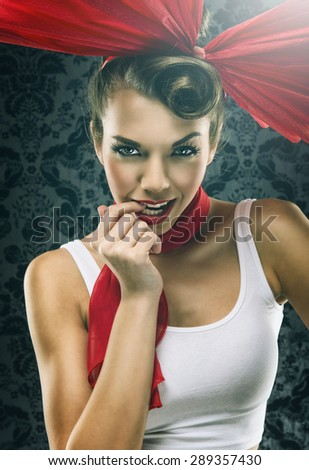 Vintage woman in red dress with big red bow - stock photo