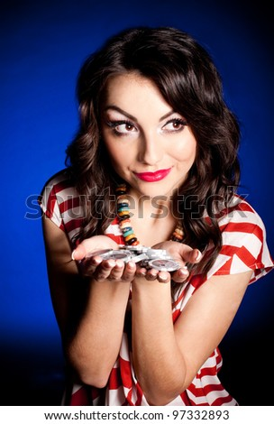 Vintage woman with casino chips on dark background - stock photo
