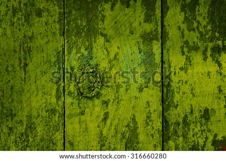 Vintage wood background with peeling paint. - stock photo