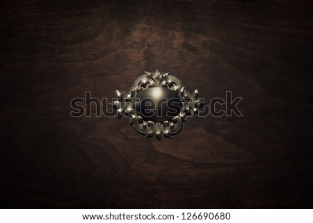 Vintage wood box with silver decoration - stock photo
