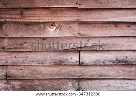Vintage wood panel western cowboy saloon style from old warehouse plenty of room for copy natural day light black and white version - stock photo