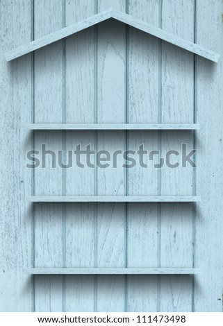 Vintage wood shelf house shape - stock photo