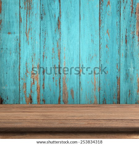 Vintage wood table in wood wall room. - stock photo