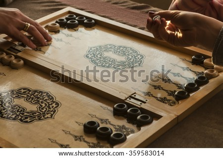 vintage wooden backgammon pattern and the dice - stock photo