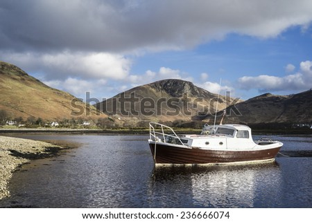 Vintage wooden boat on Lochranza on the Isle of Arran in Scotland - stock photo