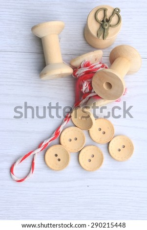 Vintage wooden bobbin thread and buttons. - stock photo