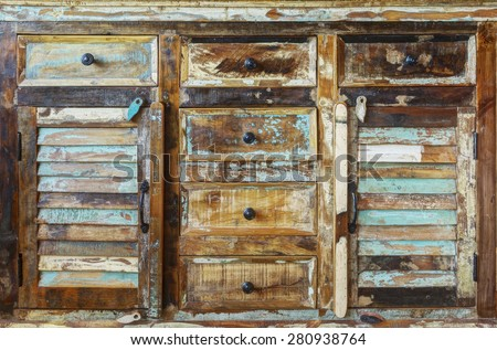 Vintage wooden cabinet with closed drawers - stock photo