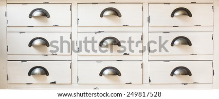 Vintage wooden cabinet with drawers - stock photo