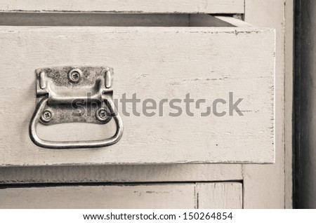 Vintage wooden cabinet with open drawer - stock photo