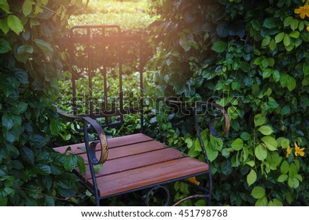 Vintage wooden chair with abstract light in the garden - stock photo
