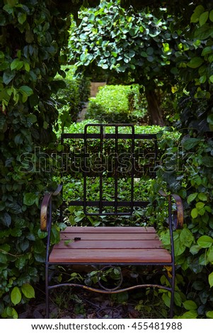 Vintage wooden chair with natural light in the garden - stock photo