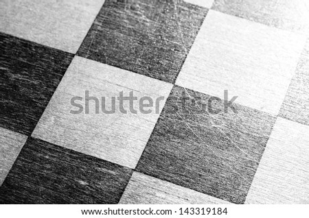 vintage wooden chessboard, close up view from above