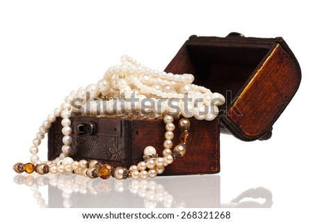 Vintage wooden chest with pearl necklaces isolated on white background - stock photo