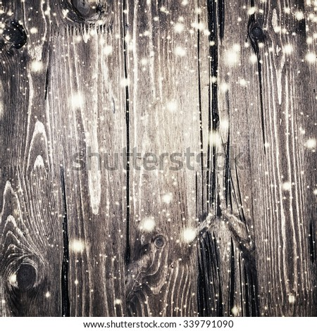 Vintage wooden Christmas background with snow. Silver xmas card with copy space. - stock photo