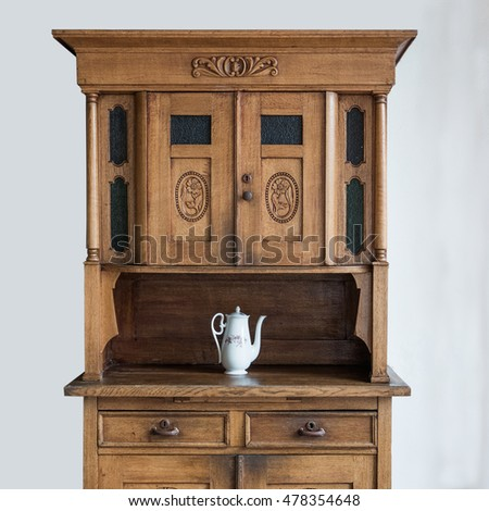 Vintage wooden cupboard with coffee pot
