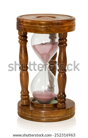 Vintage wooden hourglass with pink sand isolated on white background