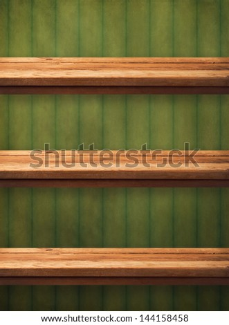 Vintage wooden kitchen shelves over grunge green wallpaper. Ready for product montage display