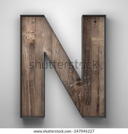 vintage wooden letter n with metal frame