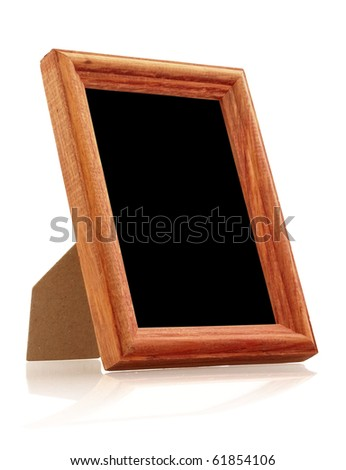 vintage wooden photo frame on white background with reflection - stock photo