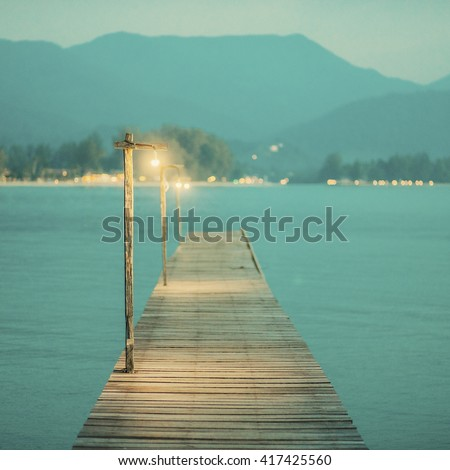 Vintage wooden pier at night. Tropical islands. Postcard travel inspiration. Vacation wallpaper.  - stock photo