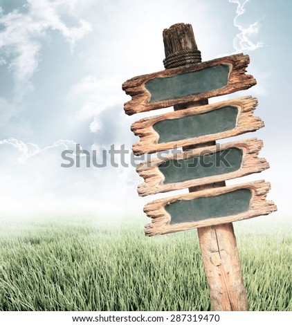 Vintage wooden sign on nature background with copy space. - stock photo