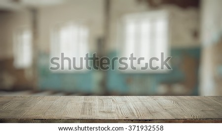 vintage wooden table in old room - stock photo
