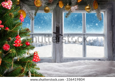 Vintage wooden window overlook winter landscape. Christmas tree on foreground - stock photo