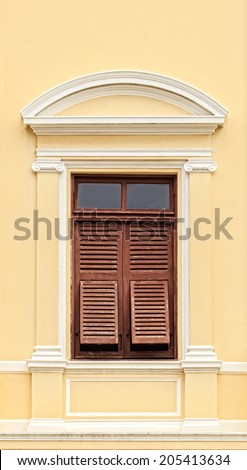 Vintage Wooden Window with shutters in colonial architecture style building - stock photo