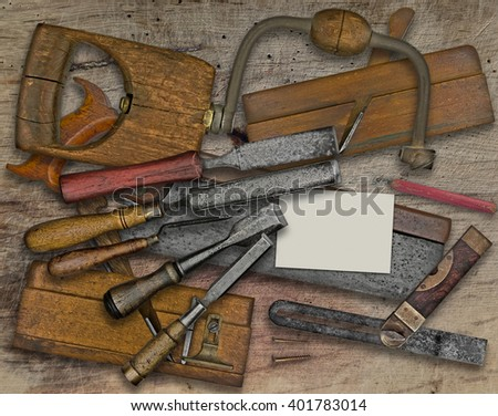 vintage woodworking  tools over wooden bench, business card for your text - stock photo
