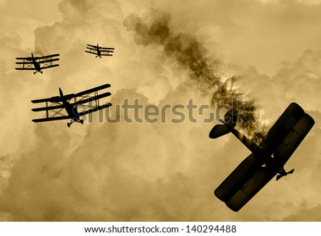 Vintage world war one biplanes and triplanes engaged in a dog fight  in a cloudy sky. One had success in shooting down the enemy plane. Original Illustration image. - stock photo