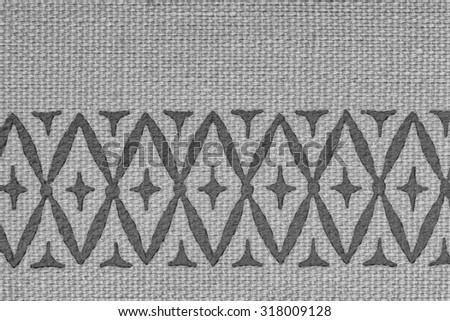 Vintage woven cloth fragment with pattern/texture in tones of black, white, and gray/grey, for use as an advertisement background. - stock photo