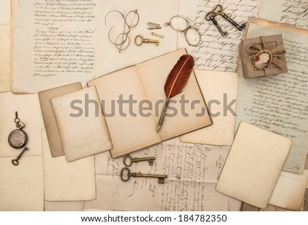 vintage writing accessories, old papers, letters and keys. documents and manuscripts - stock photo