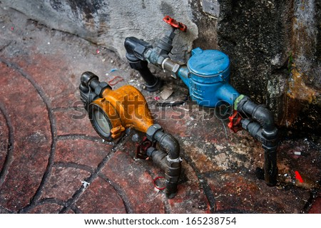 vintage yellow and blue water meters  - stock photo
