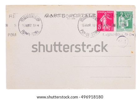 Vintage yellowed postcard back side, circa 1937, with old french post and meter stamps, with text Postcard and name of french village Mont Dore, isolated on white background